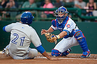 Catcher Chad Noble #15 of the Daytona Cubs tags out Michael Crouse #21 at home plate during the game against the Dunedin Blue Jays at Jackie Robinson Ballpark on April 10, 2012 in Daytona Beach, Florida. (Scott Jontes / Four Seam Images)