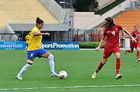 ATENÇÃO EDITOR FOTO EMBARGADA PARA VEÍCULOS INTERNACIONAIS - SAO PAULO, SP, 09 DE DEZEMBRO DE 2012 - TORNEIO INTERNACIONAL CIDADE DE SÃO PAULO - BRASIL x PORTUGAL: Cristiane (e) durante partida Brasil x Portugal, válido pelo Torneio Internacional Cidade de São Paulo de Futebol Feminino, realizado no estádio do Pacaembú em São PauloFOTO: LEVI BIANCO - BRAZIL PHOTO PRESS