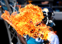 Jacksonville Jaguars tight end #89 Marcedes Lewis runs past a ball of flames during pre-game introductions at Jacksonville Municipal Stadium in Jacksonville, Fl. (The Florida Times-Union, Rick Wilson)