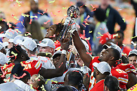 2nd February 2020, Miami Gardens, Florida, USA;   Kansas City Chiefs Defensive Tackle Chris Jones (95) holds up  the Vince Lombardi Trophy on the podium after Super Bowl LIV on February 2, 2020 at Hard Rock Stadium in Miami Gardens