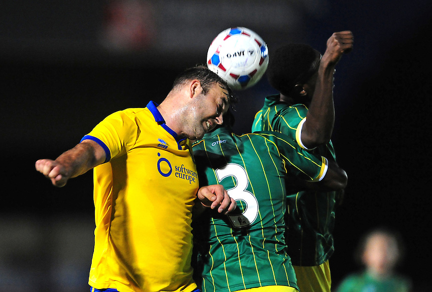 Lincoln City&rsquo;s Matt Rhead vies for possession with Norwich City&rsquo;s Michee Efete, centre, and Norwich City's Affi Coker<br /> <br /> Photographer Chris Vaughan/CameraSport<br /> <br /> Football - Football Friendly - Lincoln City v Norwich City - Wednesday 29th July 2015 - Sincil Bank - Lincoln<br /> <br /> &copy; CameraSport - 43 Linden Ave. Countesthorpe. Leicester. England. LE8 5PG - Tel: +44 (0) 116 277 4147 - admin@camerasport.com - www.camerasport.com