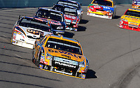 Nov. 16, 2008; Homestead, FL, USA; NASCAR Sprint Cup Series driver Matt Kenseth leads the field during the Ford 400 at Homestead Miami Speedway. Mandatory Credit: Mark J. Rebilas-