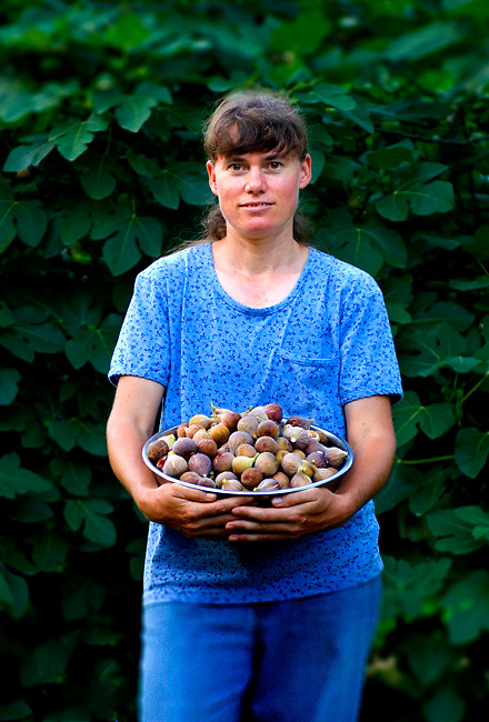 Portrait of an organic farmer holding a bowl of organic figs in DeFuniak Springs, Florida.  Photographed for Southern Progress Publishing and Sweet Tea Magazine.