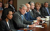 United States President George W. Bush speaks to the media regarding the economy prior to a Cabinet meeting in the Cabinet Room of the White House on October 15, 2008. From left are Secretary of State Condoleezza Rice, Bush, Treasury Secretary Henry Paulson, Commerce Secretary Carlos Gutierrez, Transportation Secretary Mary E. Peters and White House Chief of Staff Joshua B. Bolten.  <br /> Credit: Roger L. Wollenberg / Pool via CNP