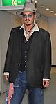 Johnny Depp, Jul 18, 2013 : Tokyo, Japan : Johnny Depp leaves at Narita International Airport in Japan on July 18, 2013.