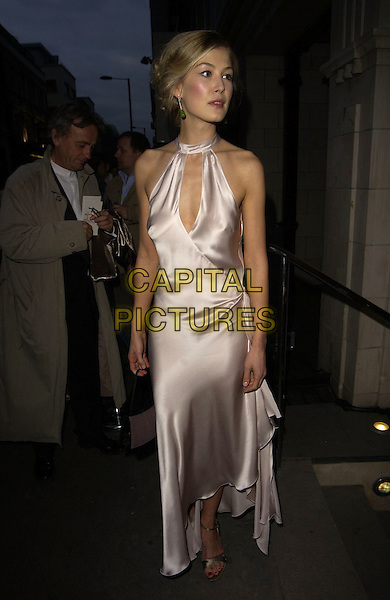 ROSAMUND PIKE.The Royal Court Theatre 50th Anniversary Gala Party, Titanic Nightclub, London, UK..April 26th, 2006.Ref: CAN.full length white cream satin halterneck dress .www.capitalpictures.com.sales@capitalpictures.com.©Capital Pictures