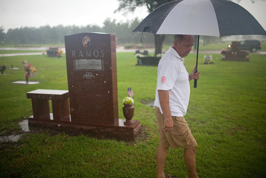 David Senko, a former construction manager at BP's Texas City refinery, visits the grave of Art Ramos in Pearland, Texas. Mr. Ramos worked for Mr. Senko along with ten others that were killed in the March 23, 2005 explosion. Fifteen people were killed that day. Mr. Senko crusades for stronger safety measures for workers, and feels that BP has not been held accountable for the 2005 catastrophe.
