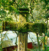 A moss covered concrete cross is yet another example of the symbolism Edward James introduced to his pleasure garden