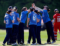 Arlene Kelly (C) is mobbed after taking a Lancashire wicket during the Women's Royal London County Championship game between Kent ladies and Lancashire ladies at the County Ground, Beckenham, on May 7, 2018