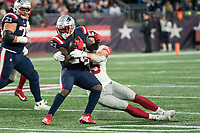 FOXBORO, MA - OCTOBER 10: New York Giants Offensive linemaner David Mayo (55) tackles New England Patriots Runningback Sony Michel (26) during a game between New York Giants and New England Patriots at Gillettes on October 10, 2019 in Foxboro, Massachusetts.