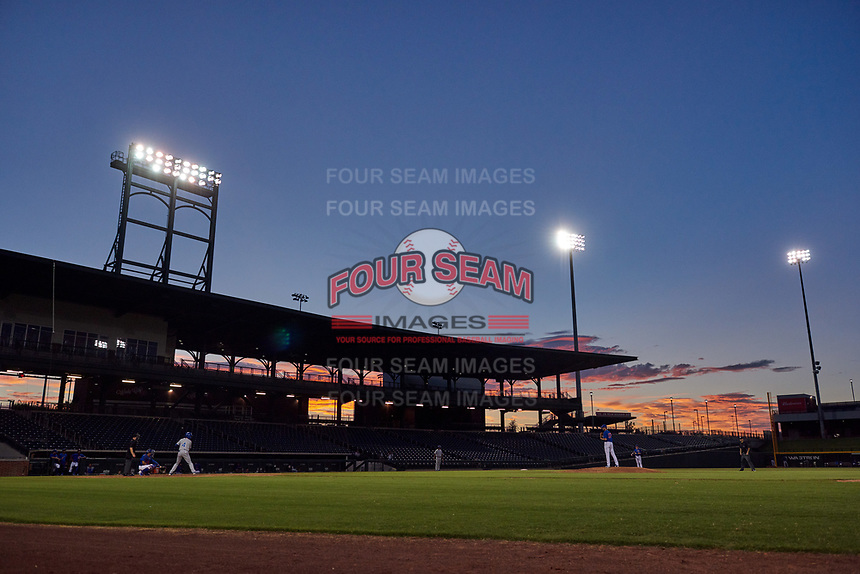 The sun sets behind Sloan Park during an Arizona League game between the AZL Royals and AZL Cubs 1 on June 30, 2019 in Mesa, Arizona. AZL Royals defeated the AZL Cubs 1 9-5. (Zachary Lucy/Four Seam Images)
