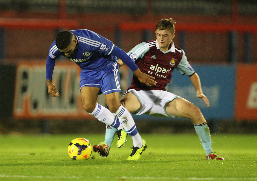 Chelsea's Alex Kiwomya  despite the attentions of  West Ham United's Taylor Miles  <br /> <br /> Photo by Kieran Galvin/CameraSport<br /> <br /> Football - Barclays U21 Premier League - Chelsea U21 v West Ham United U21 - Friday 1st November 2013 - Electrical Services Stadium - Aldershot <br /> <br /> &copy; CameraSport - 43 Linden Ave. Countesthorpe. Leicester. England. LE8 5PG - Tel: +44 (0) 116 277 4147 - admin@camerasport.com - www.camerasport.com