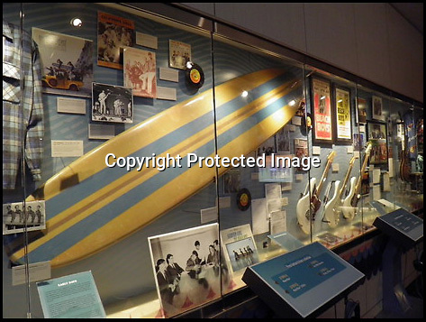 BNPS.co.uk (01202 558833)<br /> Pic: RockawayRecords/BNPS<br /> <br /> ****Please use full byline****<br /> <br /> Grammy Museum.<br /> <br /> A surfboard belonging to legendary Beach Boys drummer Dennis Wilson which featured on the covers of two of their most famous albums has emerged for sale for &pound;100,000.<br /> <br /> The iconic blue and yellow board was used for the cover of the Beach Boys' groundbreaking debut album, 1962's Surfin' Safari, and again in 1963 on the front of Surfer Girl.<br /> <br /> Wilson, the band's only surfer, brought the 9ft board along to the band's first ever professional photo shoot held on a beach in California in 1962 shortly after they signed with Capitol Records.<br /> <br /> The five members - Brian, Dennis and Carl Wilson, their cousin Mike Love and friend Al Jardine - were snapped holding it while striking various poses on a beach. The photos from the session went on to become some of the most iconic images of the band.<br /> <br /> Wilson gave the board to his close friend Louis Marotta in the 1970s who in turn passed it on to Beach Boys fan Bob Stafford in 1985.<br /> <br /> Mr Stafford is now selling the board with a whopping price tag of &pound;100,000 after a short stint on display at the Grammy Museum in Los Angeles to mark the band's 50th anniversary.