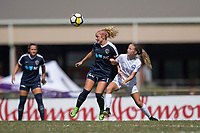 Sanford, FL - Saturday Oct. 14, 2017:  A Courage player heads the ball away from pressure during a US Soccer Girls' Development Academy match between Orlando Pride and NC Courage at Seminole Soccer Complex. The Courage defeated the Pride 3-1.