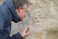 Cliff Face - Visitors stunned after the image of a human face naturally appeared in a cliff