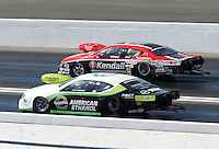 Feb. 17, 2013; Pomona, CA, USA; NHRA pro stock driver V. Gaines (far lane) races alongside Deric Kramer during the Winternationals at Auto Club Raceway at Pomona. Mandatory Credit: Mark J. Rebilas-