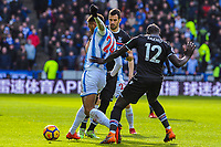 Huddersfield Town's forward Steve Mounie (24) lays of under pressure from Crystal Palace's defender Mamadou Sakho (12) during the EPL - Premier League match between Huddersfield Town and Crystal Palace at the John Smith's Stadium, Huddersfield, England on 17 March 2018. Photo by Stephen Buckley / PRiME Media Images.