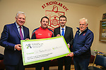 St Nicholas GFC &lsquo;Building for the Future&rsquo; Campaign.<br /> <br /> Fergus O'Dowd TD.  Dessie McDonald Chairperson St Nicholas GFC. Brendan Griffin Minister of State at the Department of Transport, Tourism and Sport  and St Nicholas GFC Treasurer Pat Clarke with the cheque for &euro;108,000 funding.<br /> <br /> Picture Fran Caffrey / Newsfile.ie<br /> <br /> All photo usage must carry mandatory copyright credit (&copy; Newsfile | Fran Caffrey)<br /> <br /> SEE PRESS RELEASE BELOW &amp; ATTACHED.<br /> <br /> MINISTER BRENDAN GRIFFIN  TURNS THE SOD AT ST. NICHOLAS GFC IN DROGHEDA<br /> Today Wednesday 7 November 2018, Minister of State for Tourism and Sport, Brendan Griffin TD, visited St. Nicholas GFC in Drogheda Co. Louth to launch their &lsquo;Building for the Future&rsquo; Campaign.<br /> About St. Nicholas GFC<br /> St. Nicholas GFC is a progressive GAA club situated along the River Boyne in Drogheda Co. Louth. The club was formed  in December 1977 and has stood its ground and lived through many successes and challenges throughout its 40 year history.<br /> This year, the Chairperson of St. Nicholas, Dessie McDonald, had the foresight to lead the club in a new direction in order to progress and ultimately safeguard the club for its young and dynamic players.<br /> &lsquo;Integration through Gaelic Football&rsquo;<br /> In June 2018, Mr McDonald took the initiative of inviting children from Mosney to take part in the club&rsquo;s weekly Gaelic Football training sessions. The club grounds at Pentony Park on the Rathmullan Road in Drogheda, are neighbouring the main primary and secondary schools attended by many of the children from Mosney which are St. John&rsquo;s National School, St. Paul&rsquo;s National School and St Oliver&rsquo;s Community College. <br /> On any one training evening, the group of up to 50 children from Mosney represented up to 10 different nationalities, playing together with children from the local  community for the one common love of Gaelic Football.  <br /> Following the overwhelming success of &lsquo;Integration through Gaelic Football&rsquo;, Mosney Management sponsored a series of 20 road