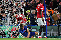 Cesc Fabregas of Chelsea collides with the camera at the side of the goal and falls into the netting at the back of the goal during Chelsea vs Manchester United, Premier League Football at Stamford Bridge on 5th November 2017