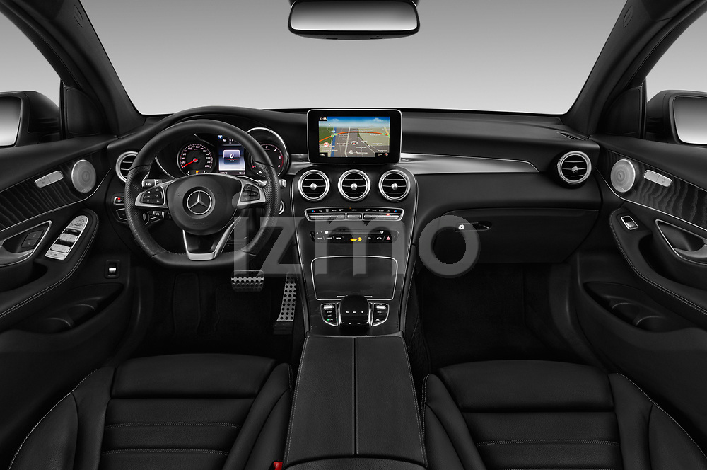 Stock photo of straight dashboard view of a 2018 Mercedes Benz GLC Coupe base 5 Door SUV
