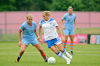 Kelly Smith (10) of the Boston Breakers is marked by Allie Long (10) of Sky Blue FC. Sky Blue FC and the Boston Breakers played to a 0-0 tie during a Women's Professional Soccer (WPS) match at Yurcak Field in Piscataway, NJ, on June 12, 2011.