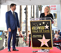 LOS ANGELES, CA. October 24, 2019: Harry Connick Jr. & Trish Kinane at the Hollywood Walk of Fame Star Ceremony honoring Harry Connick Jr.<br /> Pictures: Paul Smith/Featureflash