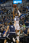 Nevada guard Jazz Johnson (22) shoots shoots a three pointer       over Colorado Christian guard Jake Hornick during the first half of an NCAA college basketball game in Reno, Nev., Wednesday, Oct. 30, 2019.