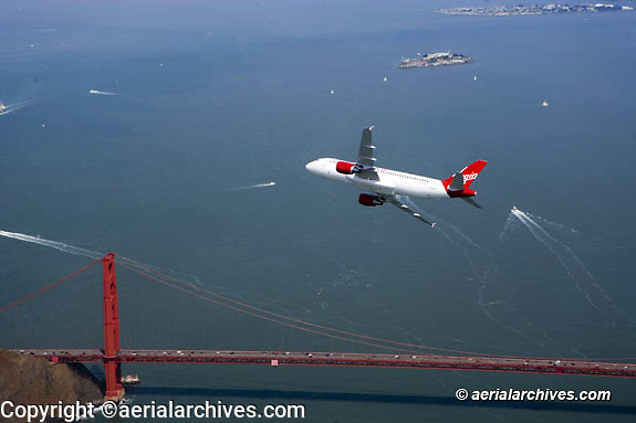 aerial photograph Virgin America Airbus a320 over Golden Gate bridge, San Francisco, California