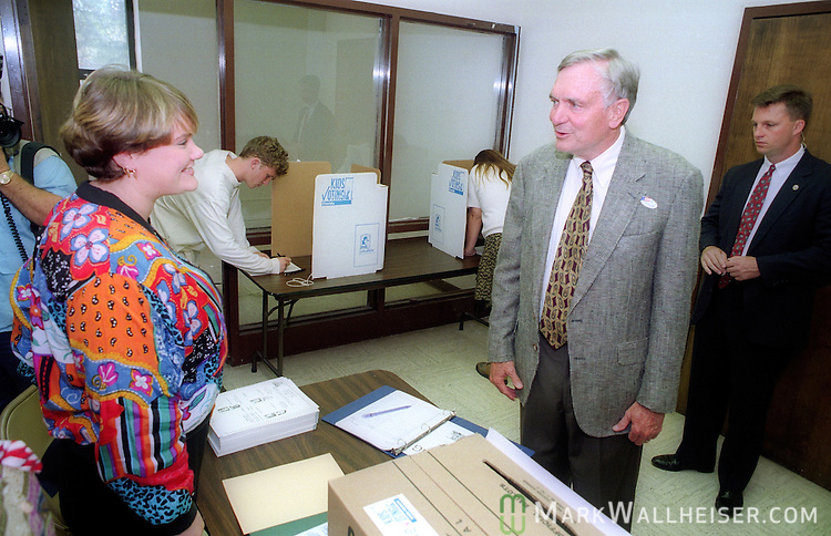 First term Florida Governor Lawton Chiles talks to poll workers when he went to the polls to vote on election day November 8, 1994.  Chiles won reelection for a second term.