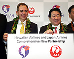 September 26, 2017, Tokyo, Japan - Hawaiian Airlines president Mark Dunkerley (L) shares smiles with Japan Airlines (JAL) president Yoshiharu Ueki as they announce to agree a comprehensive partnership at the JAL headquarters in Tokyo on Thursday, September 26, 2017. Their agreement provides for extensive code sharing, lounge access and frequent flyer program reciprocity.   (Photo by Yoshio Tsunoda/AFLO) LWX -ytd
