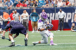 TD Ierlan (#3) loses a faceoff to Conor Mackie  (#21) and loses the head of his stick as Yale defeats UAlbany 20-11 in the NCAAA semifinal game at Gillette Stadium, May 26.