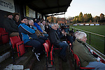 Spectators in the main stand watching the first-half action at Lye Meadow as Alvechurch (in amber) hosted Highgate United in a Midland Football League premier division match. Originally founded in 1929 and reformed in 1996 after going bust, the club has plans to move from their current historic ground to a new purpose-built stadium in time for the 2017-18 season. Alvechurch won this particular match by 3-0, watched by 178 spectators, taking them back to the top of the league.
