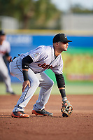 Jupiter Hammerheads third baseman J.C. Millan (24) during a game against the Dunedin Blue Jays on August 14, 2018 at Dunedin Stadium in Dunedin, Florida.  Jupiter defeated Dunedin 5-4 in 10 innings.  (Mike Janes/Four Seam Images)