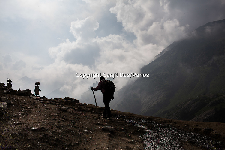 Hindu pilgrims walk along the Amarnath trekking route in Kashmir, India. Hindu pilgrims brave sub zero temperature and high latitude passes and make their pilgrimage to reach the sacred Amarnath cave, which houses a lingam - a stylized phallus, worshiped by Hindus as a symbol of God Shiva. Photo: Sanjit Das/Panos