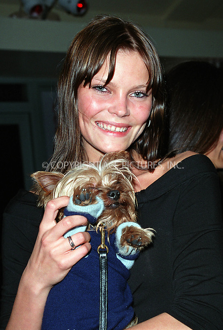 "Model MAY ANDERSEN and her dog ""Macumba"" at the Westminster Kennel Club's Tea and Biscuits Benefit to honor the search and rescue dogs and their handlers who risked their lives at Ground Zero in the heroic efforts that took place following the World Trade Center tragedy. The American Park Restaurant in New York. February 6, 2002.  © 2002 by Alecsey Boldeskul/NY Photo Press.     ....*ONE-TIME REPRODUCTION RIGHTS*      ....NY Photo Press:  ..phone (646) 267-6913;   ..e-mail: info@nyphotopress.com"
