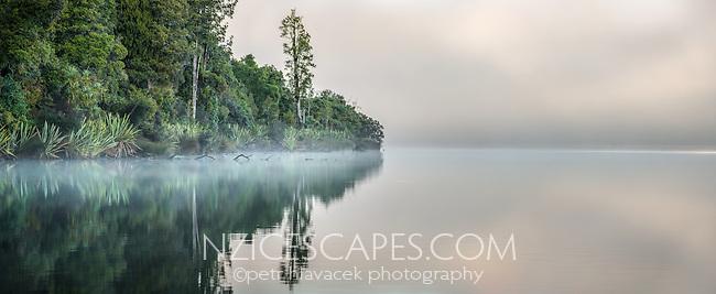 Misty winter morning with sunrise at Lake Mapourika, Westland Tai Poutini National Park, West Coast, UNESCO World Heritage Area, South Westland, New Zealand, NZ