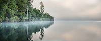 Misty winter morning with sunrise at Lake Mapourika, Westland Tai Poutini National Park, West Coast, UNESCO World Heritage Area, South Westland, New Zealand, NZ
