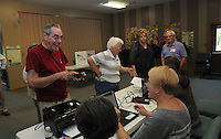 NWA Democrat-Gazette/FLIP PUTTHOFF<br /> Fay Drewry (left) stands by to get his ballot from poll workers Tuesday Sept. 15 2015 at Rogers Christian Church, 2421 W. Oak St.