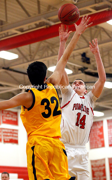 Southbury, CT- 05 February  2015-020515CM11-  Pomperaug's Matt Wynne takes a jump shot against Weston's Matthew Folger (32) during their basketball matchup in Southbury on Thursday night.   Christopher Massa Republican-American