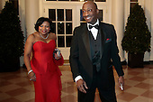 Kenneth Frazier, president and chief executive officer of Merck and Co., right, and Andrea Frazier arrive to a state dinner hosted by U.S. President Barack Obama and U.S. First Lady Michelle Obama in honor of French President Francois Hollande at the White House in Washington, D.C., U.S., on Tuesday, Feb. 11, 2014. Obama and Hollande said the U.S. and France are embarking on a new, elevated level of cooperation as they confront global security threats in Syria and Iran, deal with climate change and expand economic cooperation.<br /> Credit: Andrew Harrer / Pool via CNP