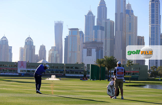 Graeme McDOWELL (NIR) plays his 2nd shot on the 18th hole during Saturday's Round 3 of the 2015 Omega Dubai Desert Classic held at the Emirates Golf Club, Dubai, UAE.: Picture Eoin Clarke, www.golffile.ie: 1/31/2015
