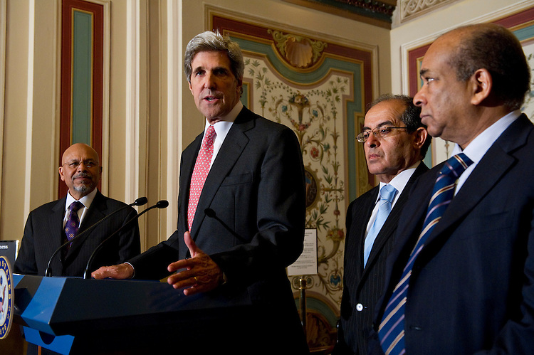 WASHINGTON, DC - May 11: Senate Foreign Relations Chairman John Kerry, D-Mass., during a news conference with Libyan representatives of the opposition to the regime of Moammar Gadhafi. With him are Ali Suleiman Aujali, Libyan ambassador to the United States who has openly backed the rebels, Mahmoud Jibril, representative for foreign affairs for the Libyan Transitional National Council, and Abdurrahman Mohamed Shalgham, who formerly served as the regime's ambassador to the United Nations. (Photo by Scott J. Ferrell/Congressional Quarterly)