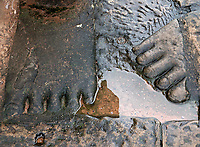 Feet in Stone, archaeology area near Bayon Temple, Siem Reap Cambodia