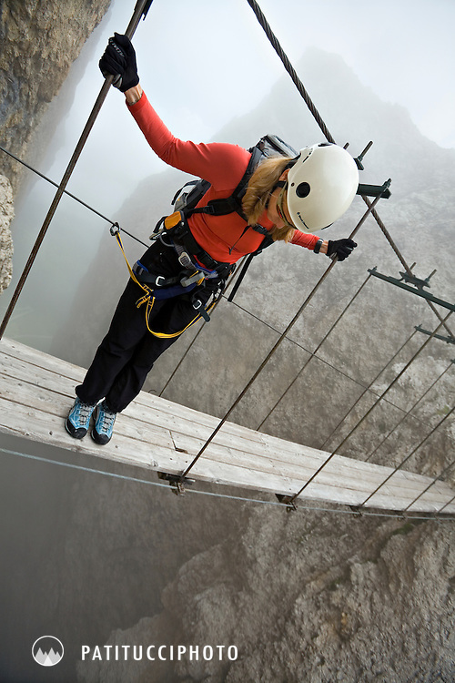 Amy Rasic climbing the Via Ferrata Tridentina in the Sella Group above Corvara, Italy. Via Ferratas are very popular in the Italian Dolomites, often using cables placed during World War I but now used for exploring the many Dolomite towers.0