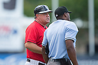 Kannapolis Intimidators manager Tommy Thompson (39) has a discussion with home plate umpire Christopher Lloyd between innings of the game against the Delmarva Shorebirds at CMC-Northeast Stadium on June 7, 2015 in Kannapolis, North Carolina.  The Shorebirds defeated the Intimidators 9-1.  (Brian Westerholt/Four Seam Images)