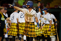 Savannah Bananas Bill Leroy (1) points to a teammate after a hit during a Coastal Plain League game against the Macon Bacon on July 15, 2020 at Grayson Stadium in Savannah, Georgia.  Savannah wore kilts for their St. Patrick's Day in July promotion.  (Mike Janes/Four Seam Images)