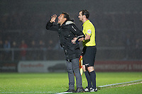 the fourth official holds back Ricardo Moniz Manager of Notts County during the Sky Bet League 2 match between Wycombe Wanderers and Notts County at Adams Park, High Wycombe, England on 15 December 2015. Photo by Andy Rowland.
