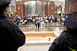 Police officers watch the participants of the March in March. Located outside the TVA headquarters in Knoxville, Tennessee. Mountain Justice Spring Break, March 14, 2009 (©Robert vanWaarden ALL RIGHTS RESERVED)