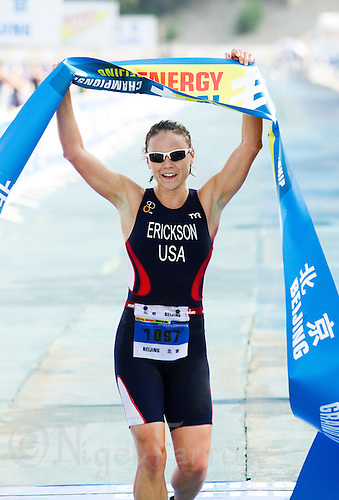11 SEP 2011 - BEIJING, CHN - Erika Erickson (USA) celebrates winning the women's 25-29 category at the 2011 ITU World Age Group Olympic Distance Triathlon Championships .(PHOTO (C) NIGEL FARROW)