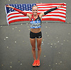 Shalane Flanagan holds an American flag as she poses for pictures after winning the women's competition in the TCS New York City Marathon on Sunday, Nov. 5, 2017. She posted a time of 2:26.53 and became the first US-born female in 40 years to claim a victory in the city's race.